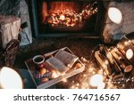 warm cozy fireplace with real... | Shutterstock . vector #764716567