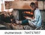 Woman Reading A Book By The...