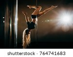 young sexy woman exercise pole... | Shutterstock . vector #764741683