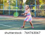 child playing tennis on outdoor ... | Shutterstock . vector #764763067