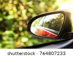 reflection of sunny autumn road ... | Shutterstock . vector #764807233