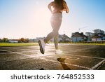 full body of girl running track ... | Shutterstock . vector #764852533