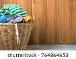 clothes in a laundry wooden... | Shutterstock . vector #764864653