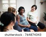 pregnant women in a class | Shutterstock . vector #764874343