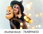 people in halloween costumes   Shutterstock . vector #764894653