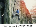Small photo of A climber climbs an ascent to a cliff.