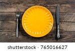 empty yellow porcelain plate ... | Shutterstock . vector #765016627