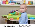 little baby boy with a blue... | Shutterstock . vector #765020683