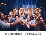 group of friends toasting with... | Shutterstock . vector #765021103