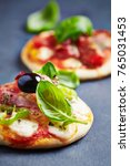 mini pizza topped with ham ... | Shutterstock . vector #765031453