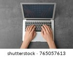 man using laptop on table  top... | Shutterstock . vector #765057613