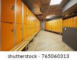locker room with orange lockers ... | Shutterstock . vector #765060313