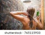woman washing hair in shower... | Shutterstock . vector #765115933