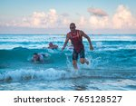 triathletes running out of the... | Shutterstock . vector #765128527