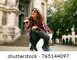 tourist couple. beautiful woman ... | Shutterstock . vector #765144097