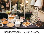 black dinner table served with... | Shutterstock . vector #765156697