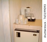 Small photo of Beatty, United States - March 21, 2003: Fridge and coffee amenities in a motel room