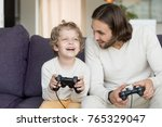 dad playing video games with... | Shutterstock . vector #765329047