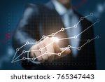 businessman clicks on the... | Shutterstock . vector #765347443