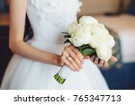 bridal white peony bouquet in... | Shutterstock . vector #765347713