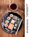 sushi set on pottery plate with ...   Shutterstock . vector #765368377