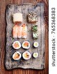sushi set on handmade pottery...   Shutterstock . vector #765368383