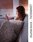 teenage girl watching video...   Shutterstock . vector #765368407
