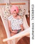 teenage girl with towel on head ...   Shutterstock . vector #765368413