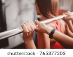 squats with a barbell  coach... | Shutterstock . vector #765377203