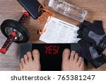 digital scales with male feet... | Shutterstock . vector #765381247