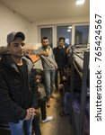 Small photo of Adasevci, Serbia, 11/15/17 refugee camp. Afghan refugees relax in their rooms before attempting to cross the Serbian/Croatian border.