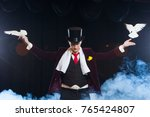 the magician with a two flying... | Shutterstock . vector #765424807