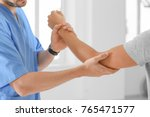 physiotherapist working with... | Shutterstock . vector #765471577