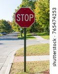 red stop sign on the suburban... | Shutterstock . vector #765474253