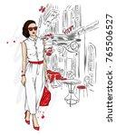 beautiful girl in a stylish... | Shutterstock .eps vector #765506527