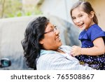 happy latin mom and little... | Shutterstock . vector #765508867