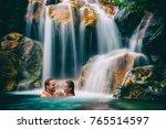 waterfall couple relaxing in... | Shutterstock . vector #765514597