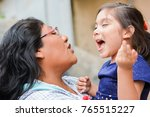 latin mom and little daughter... | Shutterstock . vector #765515227