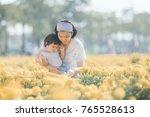 mom finger point teaching to... | Shutterstock . vector #765528613