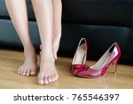 foot pain woman sitting ... | Shutterstock . vector #765546397