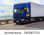 truck is moving along the...   Shutterstock . vector #765587713