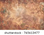 Small photo of Aged copper plate texture with green patina stains. Old worn metal background.
