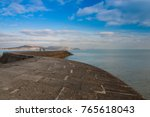 the famous cobb in lyme regis ... | Shutterstock . vector #765618043