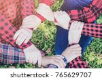 people group join hands... | Shutterstock . vector #765629707
