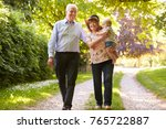 grandparents on walk in... | Shutterstock . vector #765722887