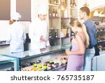 positive male pastry chef... | Shutterstock . vector #765735187