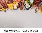 assorted cheeses and... | Shutterstock . vector #765745993