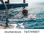 child swimming at the pool with ... | Shutterstock . vector #765749857
