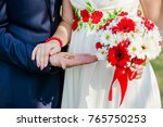 wedding rings and bouquet | Shutterstock . vector #765750253
