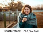 happy woman warming up with hot ... | Shutterstock . vector #765767563